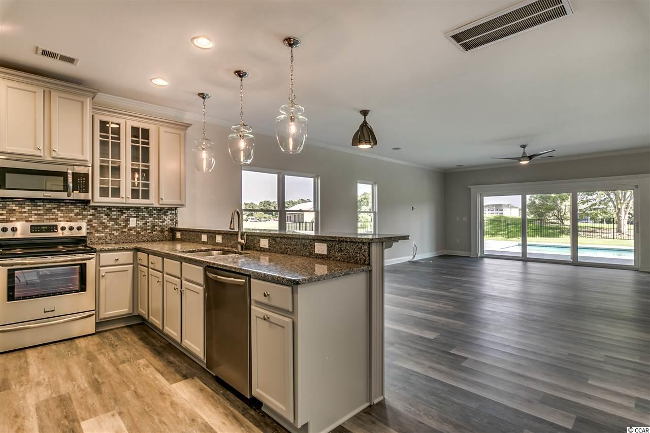 Contact your Realtor for this 4 bedroom house for sale at  Barefoot Resort - Tuscan Sands