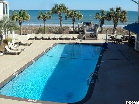 Contact your real estate agent to view this  Poolside condo for sale