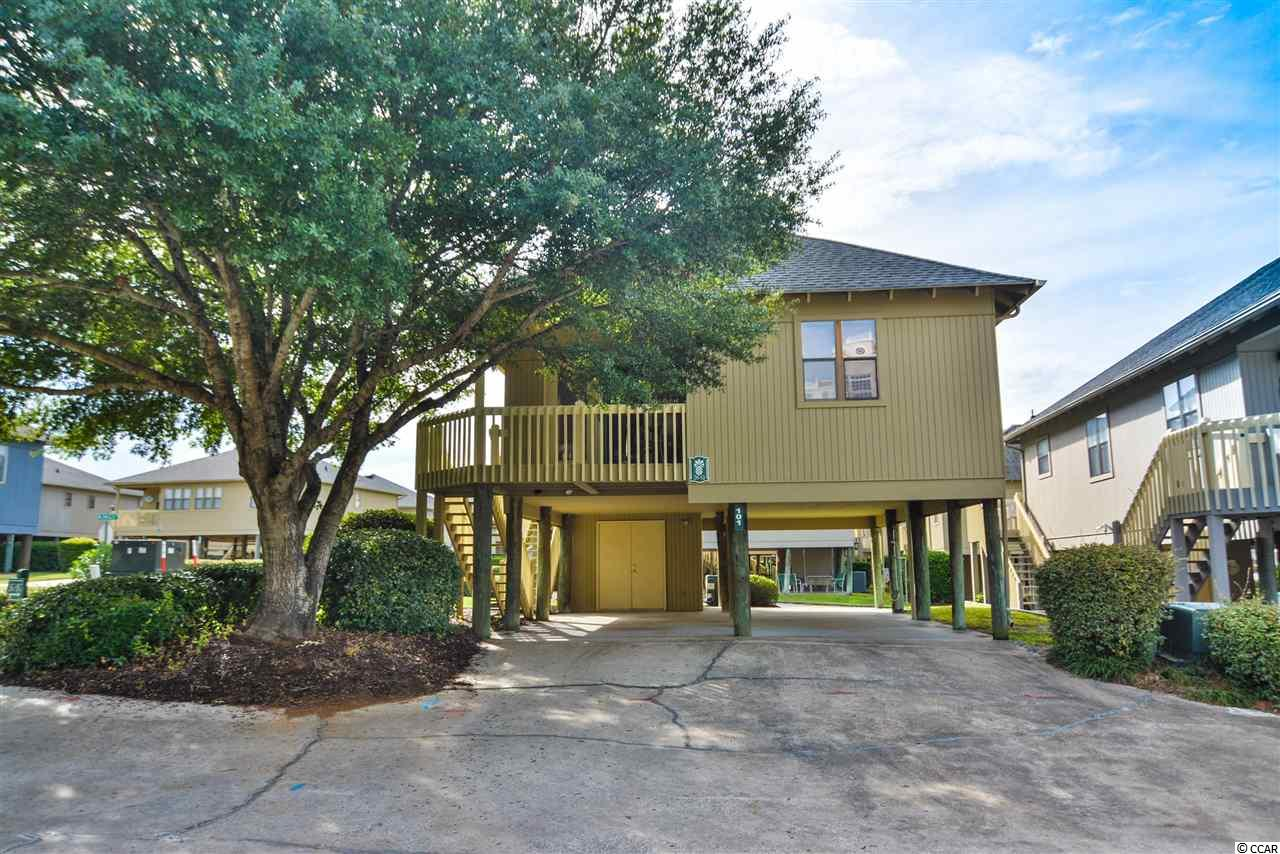 Homes for sale at guest cottage myrtle beach for Homes for sale with guest house