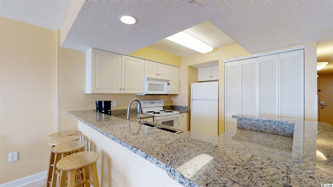 Grande Shores condo at 201 77th Ave N for sale. 1708055
