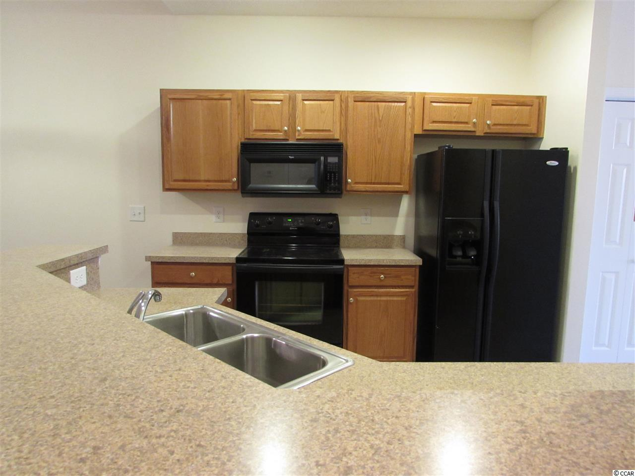 TANGLEWOOD AT BAREFOOT RESORT condo at 6095 Catalina Dr. for sale. 1708690