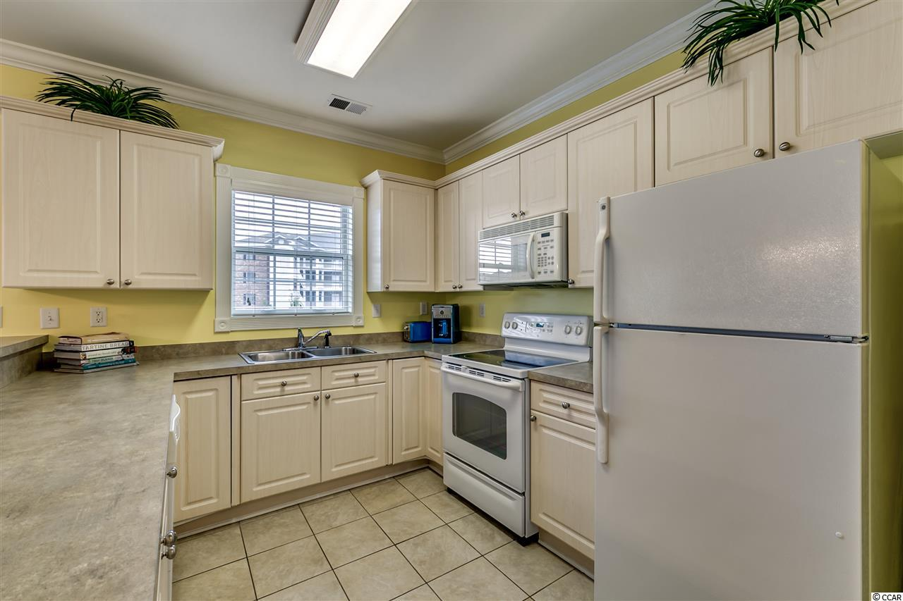 Magnolia Pointe condo at 4855 Luster Leaf Circle for sale. 1711218