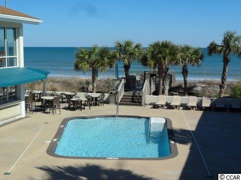 Poolside  condo now for sale