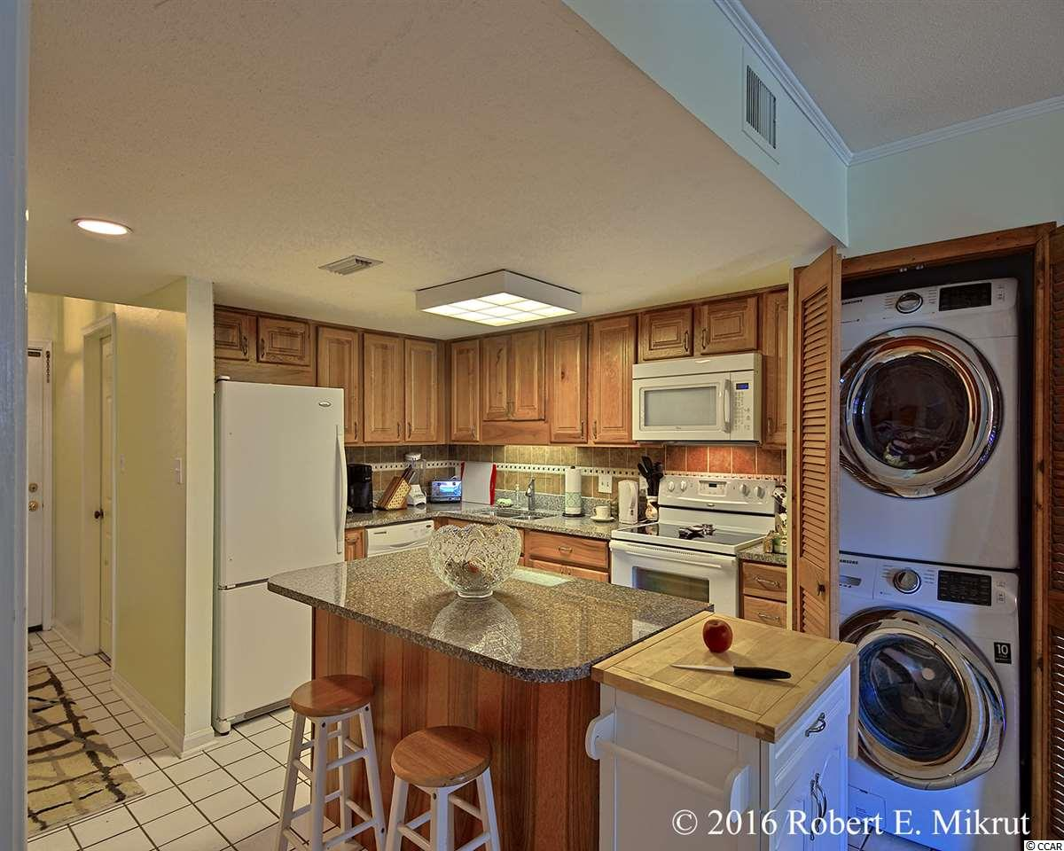 Contact your Realtor for this 2 bedroom condo for sale at  Palm Ridge II
