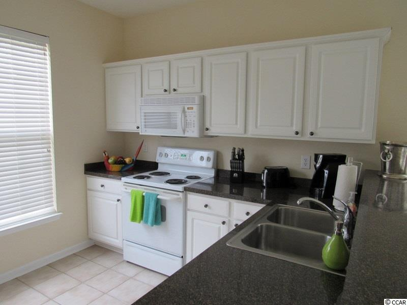 ST ANDREWS TOWNHOMES condo at 201-A CONNEMARA DR for sale. 1715570
