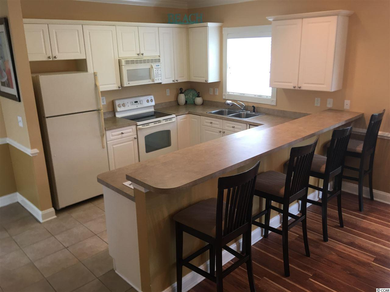 Check out this 3 bedroom condo at  MAGNOLIA POINTE