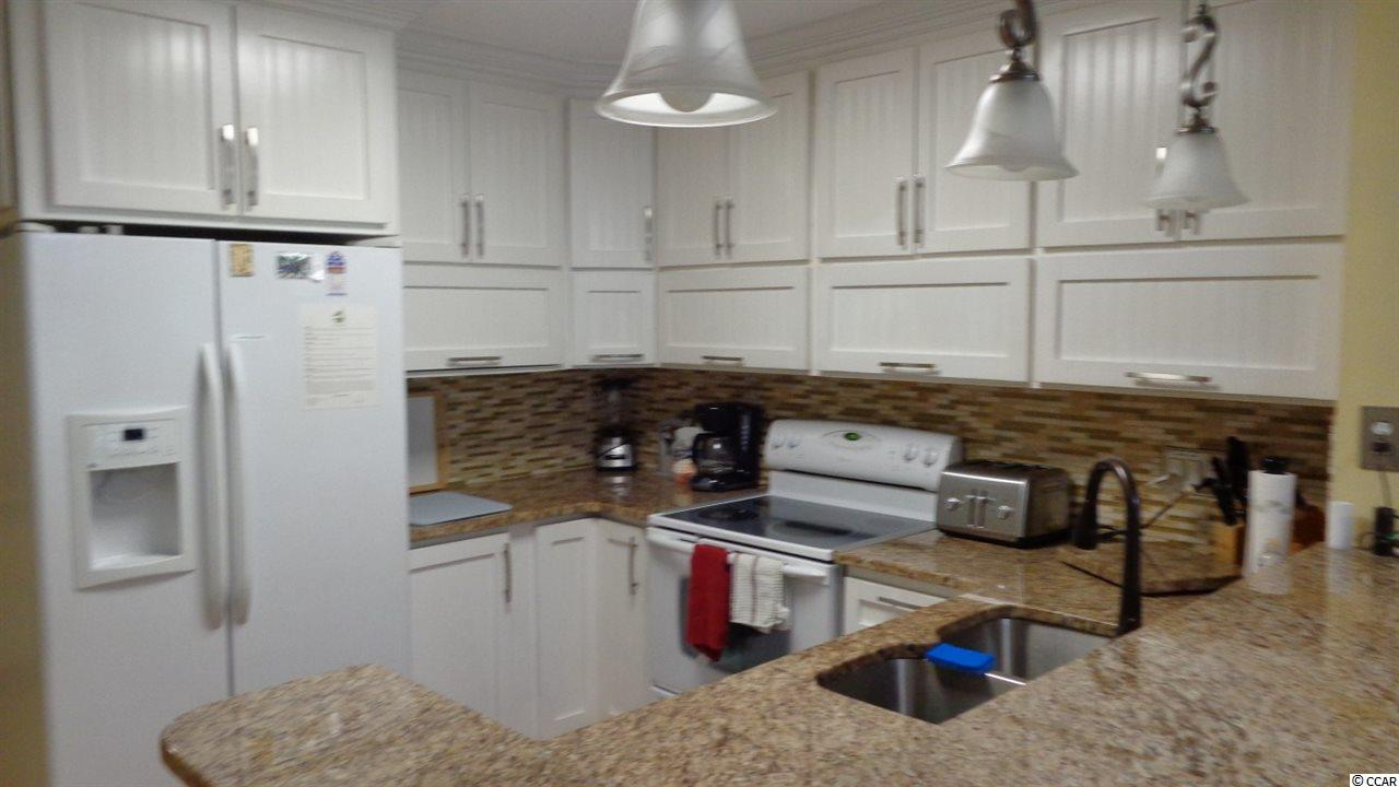 Pelicans Watch condo at 9570 Shore Drive for sale. 1717036