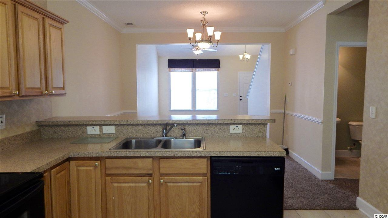 TANGLEWOOD AT BAREFOOT RESORT condo at 6095 Catalina Dr. for sale. 1717072