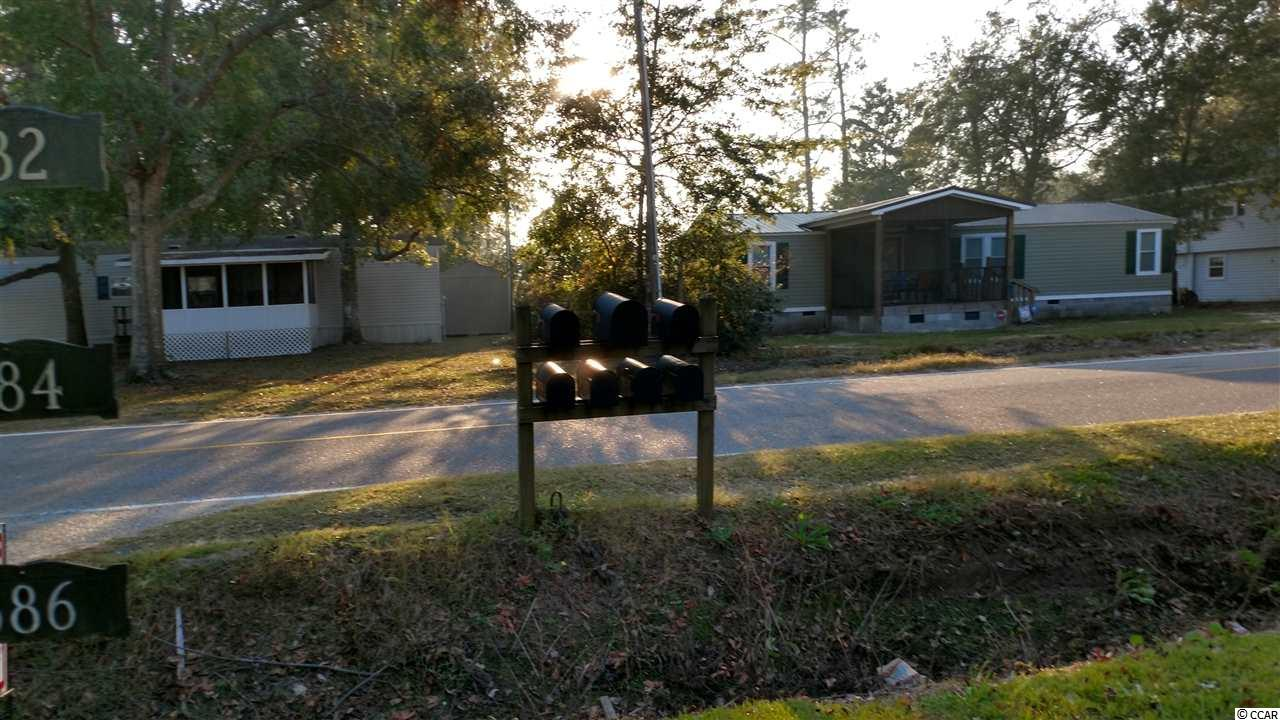 Single Family Home for Sale at 576 Woodland Drive 576 Woodland Drive Garden City Beach, South Carolina 29576 United States