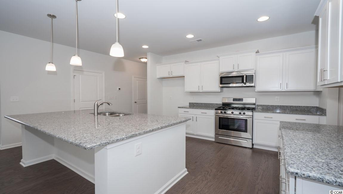 Additional photo for property listing at 108 Ocean Commons Drive 108 Ocean Commons Drive Surfside Beach, Carolina Del Sur 29575 Estados Unidos