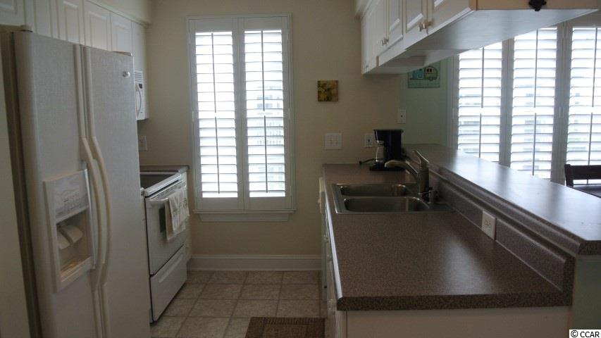 This property available at the  Jasmine Lake in Garden City Beach – Real Estate