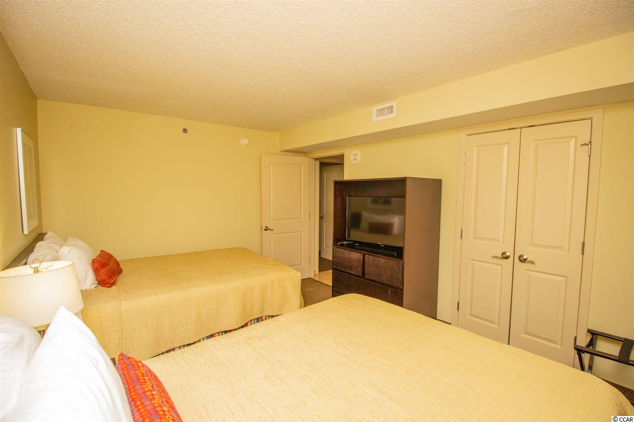 This 2 bedroom condo at  Seaside Inn is currently for sale