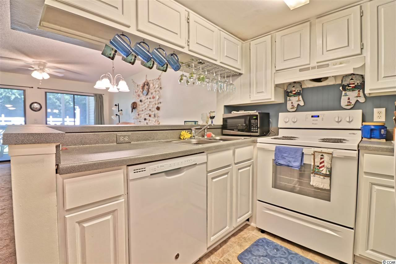 NMB Golf & Tennis condo at 1100 Possum Trot for sale. 1717998