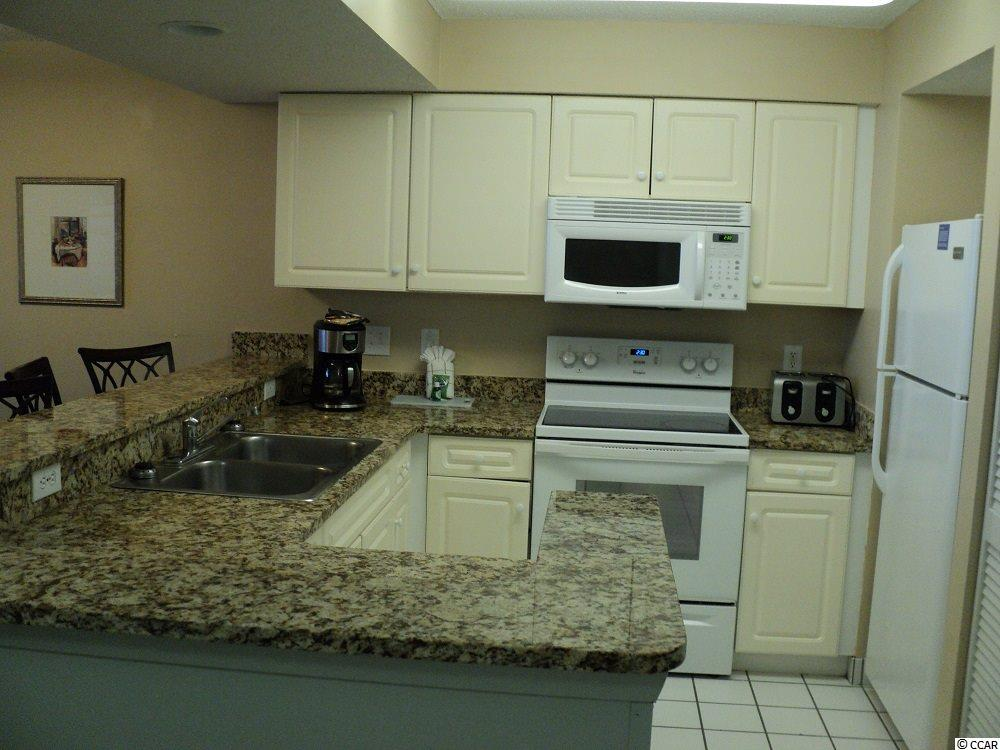 Grande Shores condo at 201 N 77th Ave. for sale. 1718025