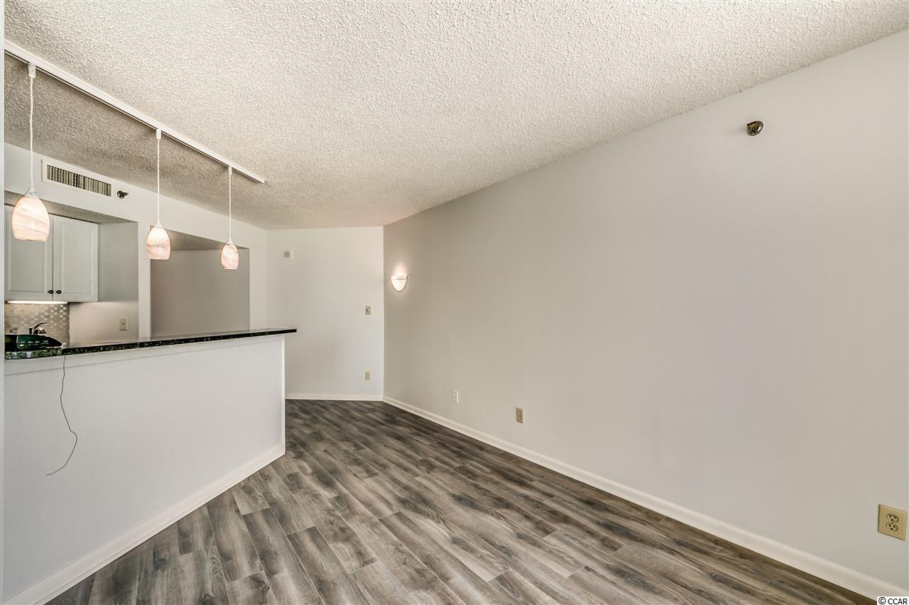 Ocean Forest Plaza condo at 5523 N Ocean Blvd for sale. 1718567