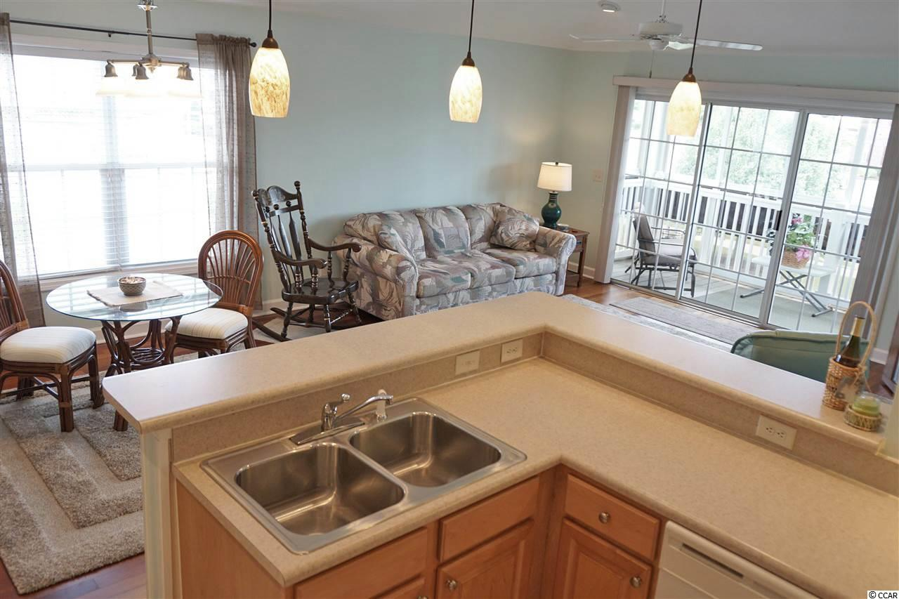 THE LAKES @ BRN condo at 8855 Radcliff Drive NW 59C for sale. 1718648