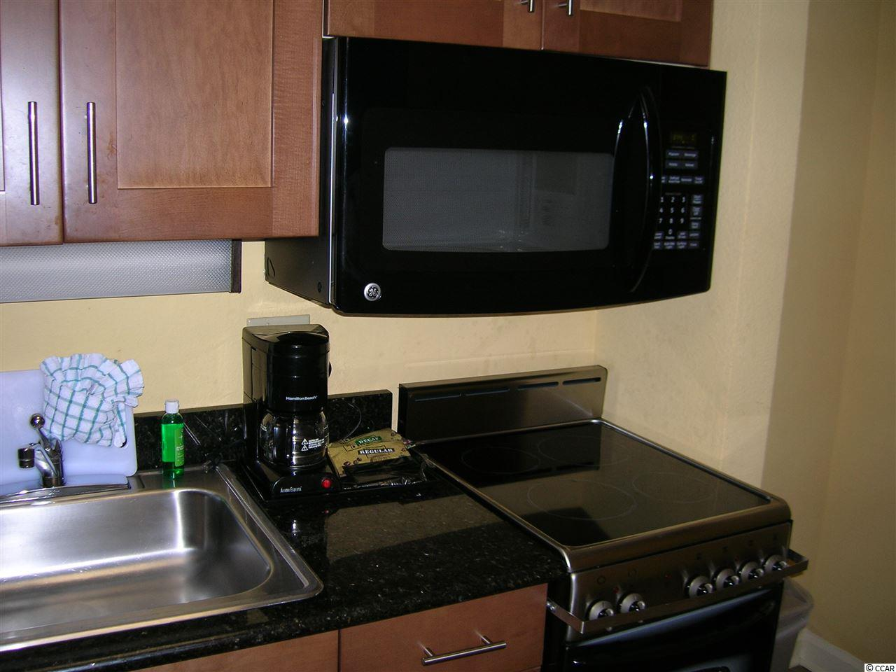 condo for sale at  Holiday Pavilion for $129,000