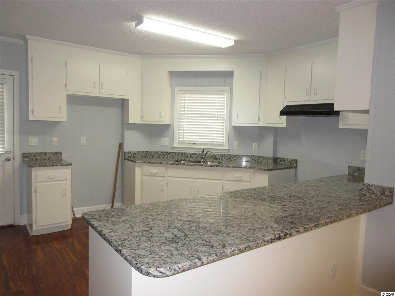 Additional photo for property listing at 744 S Waccamaw Drive 744 S Waccamaw Drive Garden City Beach, South Carolina 29576 United States
