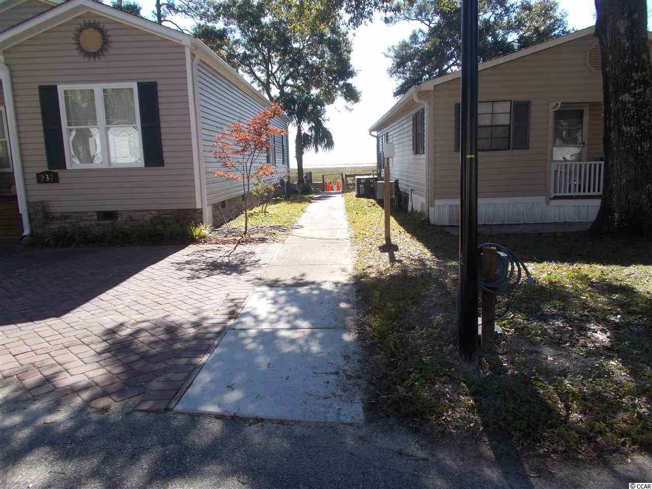 This 2 bedroom house at  Myrtle Beach RV Resort is currently for sale
