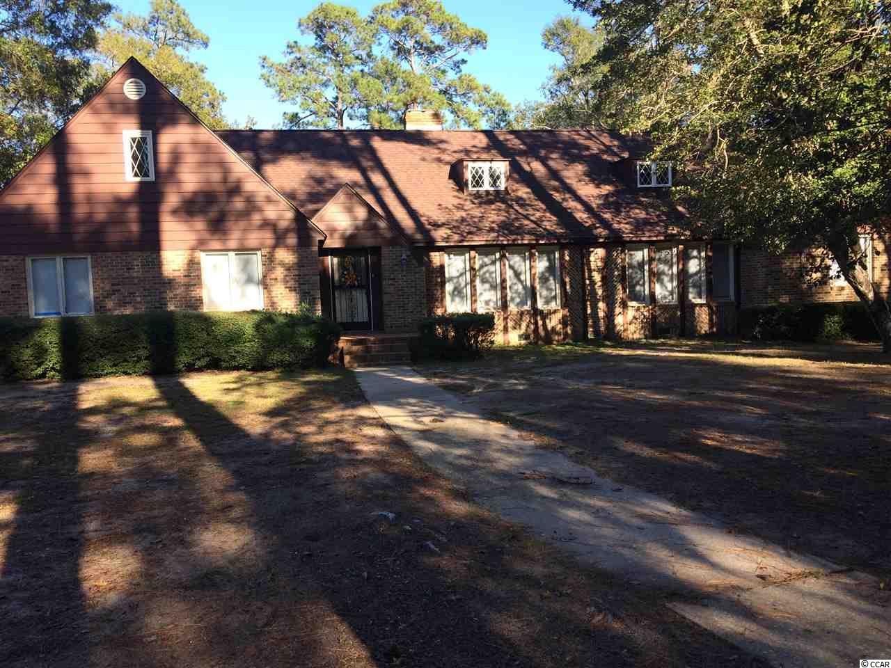 This is a one of a kind property, home sites on 1.95 acres with over 370ft of Waccamaw River frontage. Home has a private boat ramp and a large boat house. Inside the home features 3 bedrooms, 2 baths, 2 fireplaces, 2 large living areas, a formal dinning room, and a welcoming formal foyer. Out back has a large private patio over looking the Waccamaw River with moss covered trees, azaleas, and camellias great for entertaining. Home is a must see to appreciate.