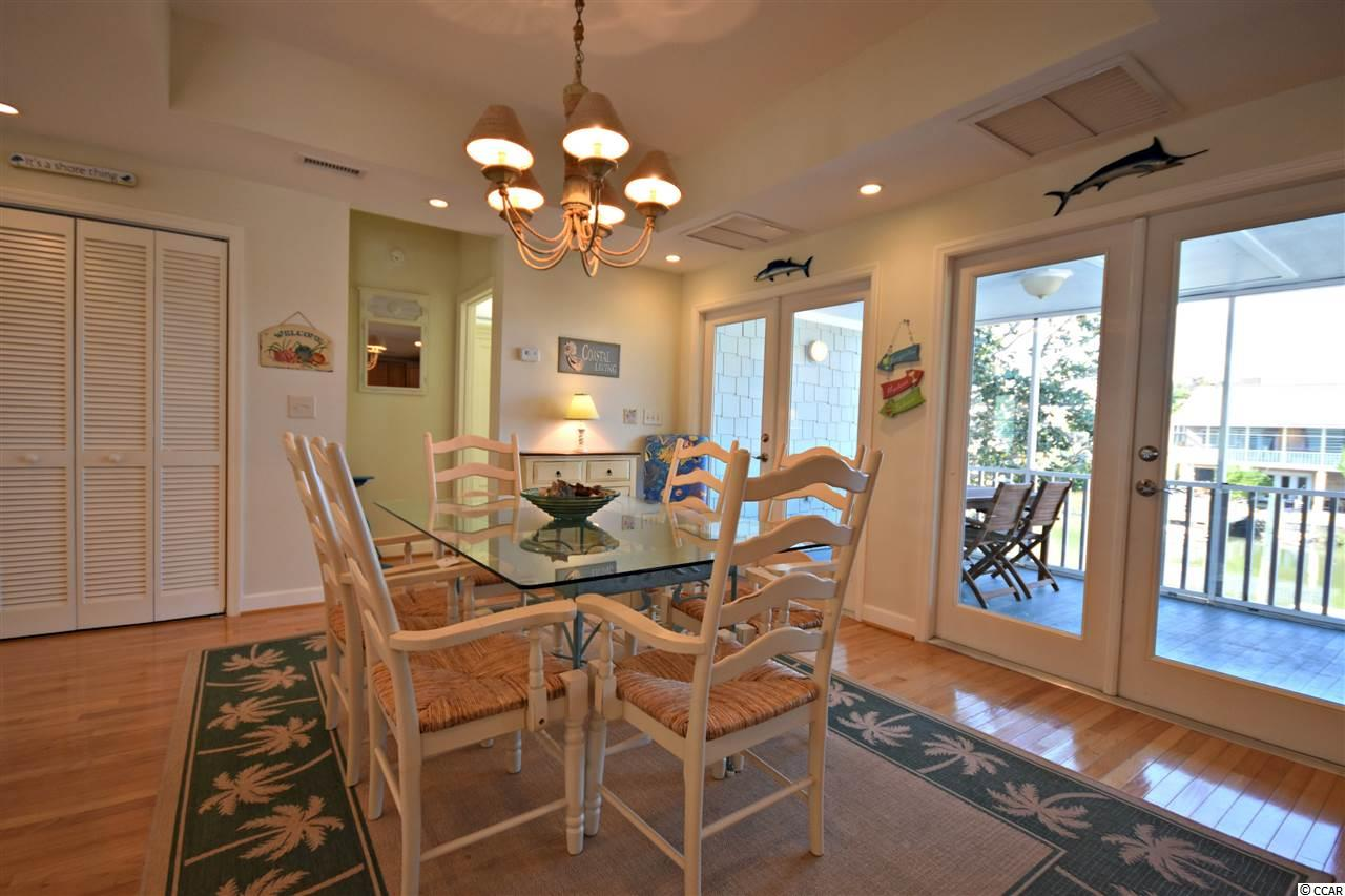 house at  Litchfield Beach for $595,000
