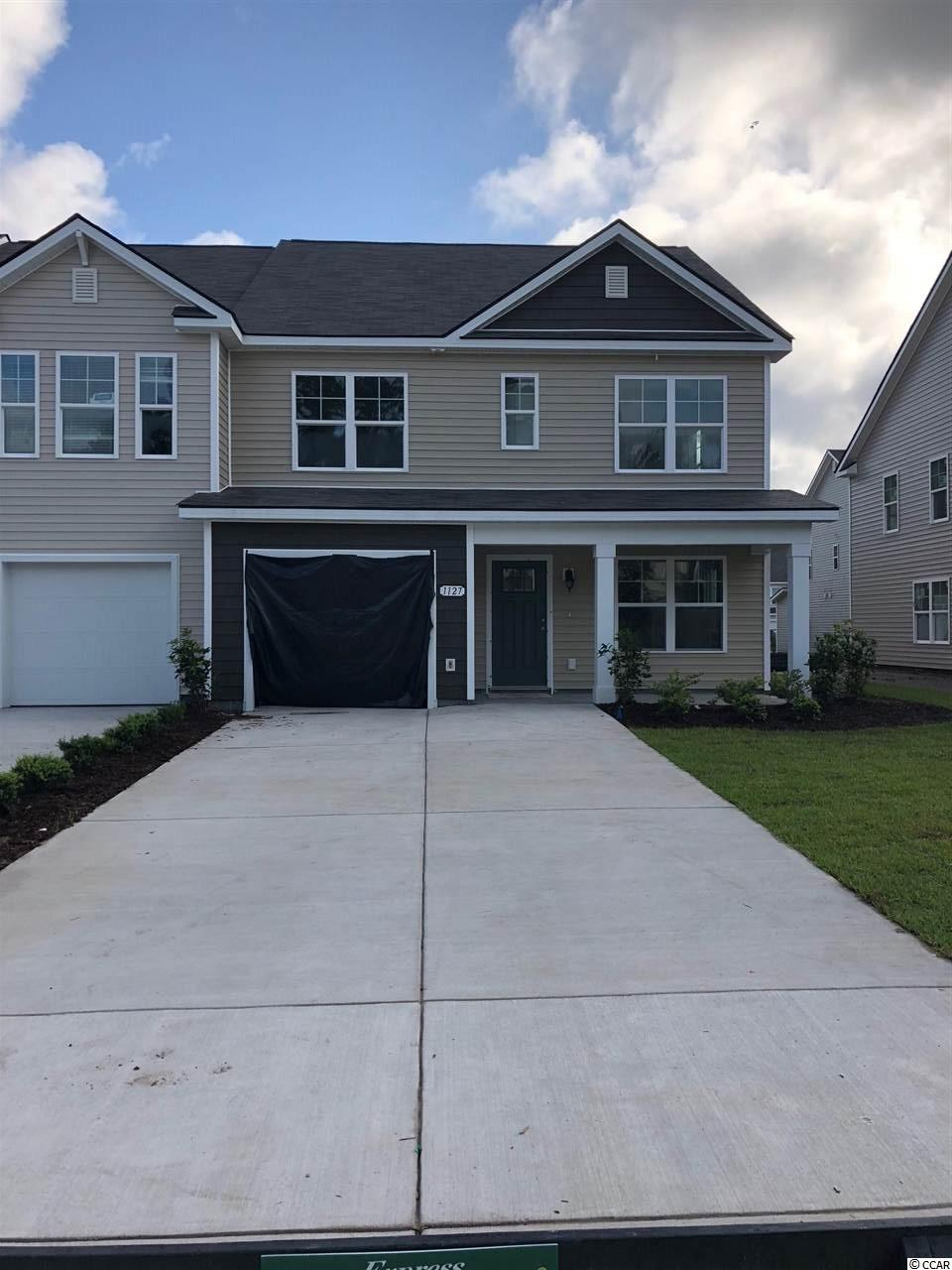 Townhouse MLS:1809214 Fairways at Wild Wing  1127 Fairway Ln. Conway SC