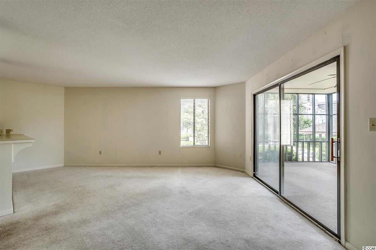 Palm Ridge II condo at 310 73rd Ave. N for sale. 1813888