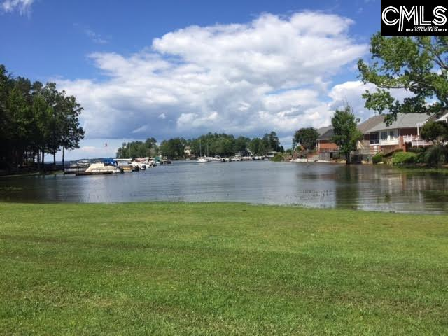 Million dollar view at an affordable price.  3 Bedroom 2 Bath on Lake Murray.  Unit has incredible view of Lake and Pool.  Freshly painted and new flooring.  Ready for new owner. This unit has a fabulous view of the lake.