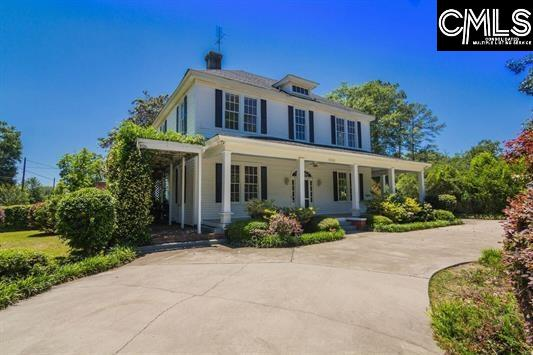 One of Shandon's Oldest Homes. Huge Landscaped Yard.  Home's exterior features a circular driveway and wrap around porches.  Interior has hardwood floors throughout.  High ceilings and heavy molding.  Kitchen has granite countertops with copper hood over center island.