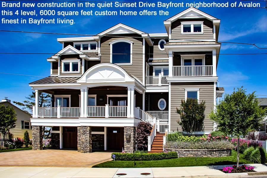 Picture entertaining family and friends or just relaxing enjoying amazing sunsets in this spectacular Bayfront setting and home. Arguably one of Avalon's premiere if not THE premiere Bayfront neighborhood Sunset Drive offers excellent waterways, extraordinary views year round, a Bayfront playground for fishing, crabbing, boating, kayaking and paddle boarding and exceptional beach just a short walk away. No other Seven Mile Island Bayfront location offers all of these special features and more!  This custom 6000 square foot home maximizes the 73'wide lot with all living areas inside and out facing onto the bay. Built under the V zone requirements the home is virtually four levels high. Four ensuite bedrooms along with an 1160 sq. ft. great room have direct access to bayside decks. Two 38'x20' bayside decks provide excellent entertaining space extending your indoor living space to the outside. The exquisite finishes throughout the home include a one of a kind glass floating staircase, unique custom linear fireplace, level 6 granite kitchen islands, custom Woodhaven cabinetry throughout, Italian ceramic tile flooring through the entire 1160 square foot great room and all halls, state of art appliance package, four stop elevator, all-house audio with IPad station control, Christmas lighting package are a few specialty finishes to name a few. The premiere lighting package and entertainment / audio system are specialty touches you will appreciate while enjoying an evening on the bay. You simply need to see the home to fully appreciate the attention to detail throughout.   The bayside oasis on the ground level is set up for afternoons of bayside fun. Imagine relaxing poolside enjoying the views and afternoon sun – or the shelter of shade while still enjoying the pool and outdoors.  The pool has additional jets along the seated shelf area.  Adjust the heat up and your pool becomes a Jacuzzi for cool fall evenings as you watch the sunset or your favorite football game on the outside television.  A wonderfully cozy fire pit with built in seating is the perfect spot to relax after enjoying the warmth of the Jacuzzi.  Specialty lighting and sound system create the perfect environment to enjoy your backyard oasis. A granite bar and outdoor cooking area plus spectacular pedestal granite topped dining table are the perfect place to entertain.    The first floor garage and storage area offers two indoor/outdoor showers with plenty of closet storage for towels and bathing attire. Conveniently located powder room and additional kitchen area is found on this ground level area along with abundant storage for all your bayside toys plus direct easy access from the garage to the bay for your kayaks and boards.  The 73' bay frontage provides for your own marina. After fun on the bay a short walk finds you on the beach or recreation areas the entire family will enjoy. There is simply nothing like 7668 Sunset Drive. We invite any pre-qualified prospective buyers to schedule a personal tour of this one of a kind home.