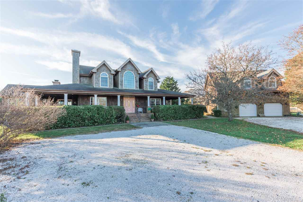 Don't miss this opportunity to own Bay Springs Farm located in the center of a rare natural dune forest on the island of Cape May. This wonderful oasis consists of a preserved 10 acre parcel, 4445 square feet of living split between a 3 bedroom, 3.5 bath home and a loft efficiency guest quarters above a large 2 bay garage. This custom built home offers hardwood floors, 2 fireplaces, a living room, dining room, breakfast room, eat-in kitchen with center island and cherry cabinets, a pantry, a family room, laundry room and a large 1st floor master w/bath, There are two 2nd floor bedrooms; a master w/ bath, and a bedroom/office w/bath. The home is equipped with a Vector security system, central vac, and a 2- zone heating/AC system. The 2- bay garage offers plenty of storage for all your tools and farm vehicles plus a spacious 2nd floor room with a sleeping area, living room area and a kitchenette. There are two barns, a store, fenced pastures and a pond. There are solar panels on the house & barn and two Generac generators. In operation since 1999, it is the oldest alpaca breeding farm in New Jersey, offering show quality Peruvian & Chilean bloodlines, fine fleece, diverse colors and excellent conformation. Daily handling and contact with visitors insures that the alpacas are friendly, safe for children, and fun to be around. This wonderful parcel is a magnet for birders and an oasis for coastal migrants and just minutes to Cape May shopping and beaches.