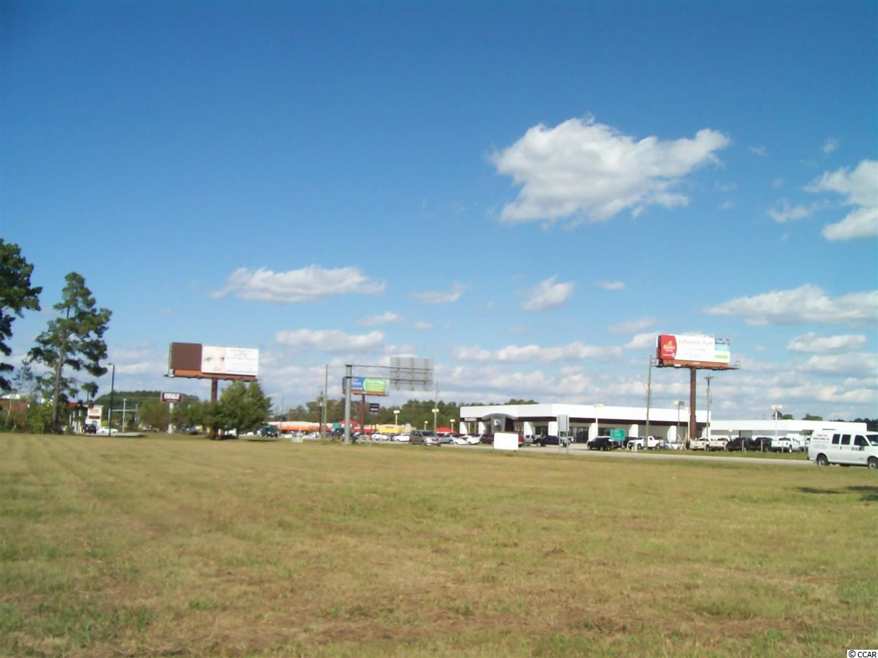 With over 300 feet of direct highway frontage with two curb cuts on Hwy 9 just East of BB&T and CVS – this 1.8 acre site is cleared and ready for immediate use. Site may be subdivided with approved user but owner would prefer single tenant. Great area for fast food or retail. Join Goodwill, Bojangles, Conway National Bank, Bell & Bell GMC/Buick, CVS, and BB&T at this great commercial location. Acreage is approximate and not guaranteed. Lessee is responsible for verification.