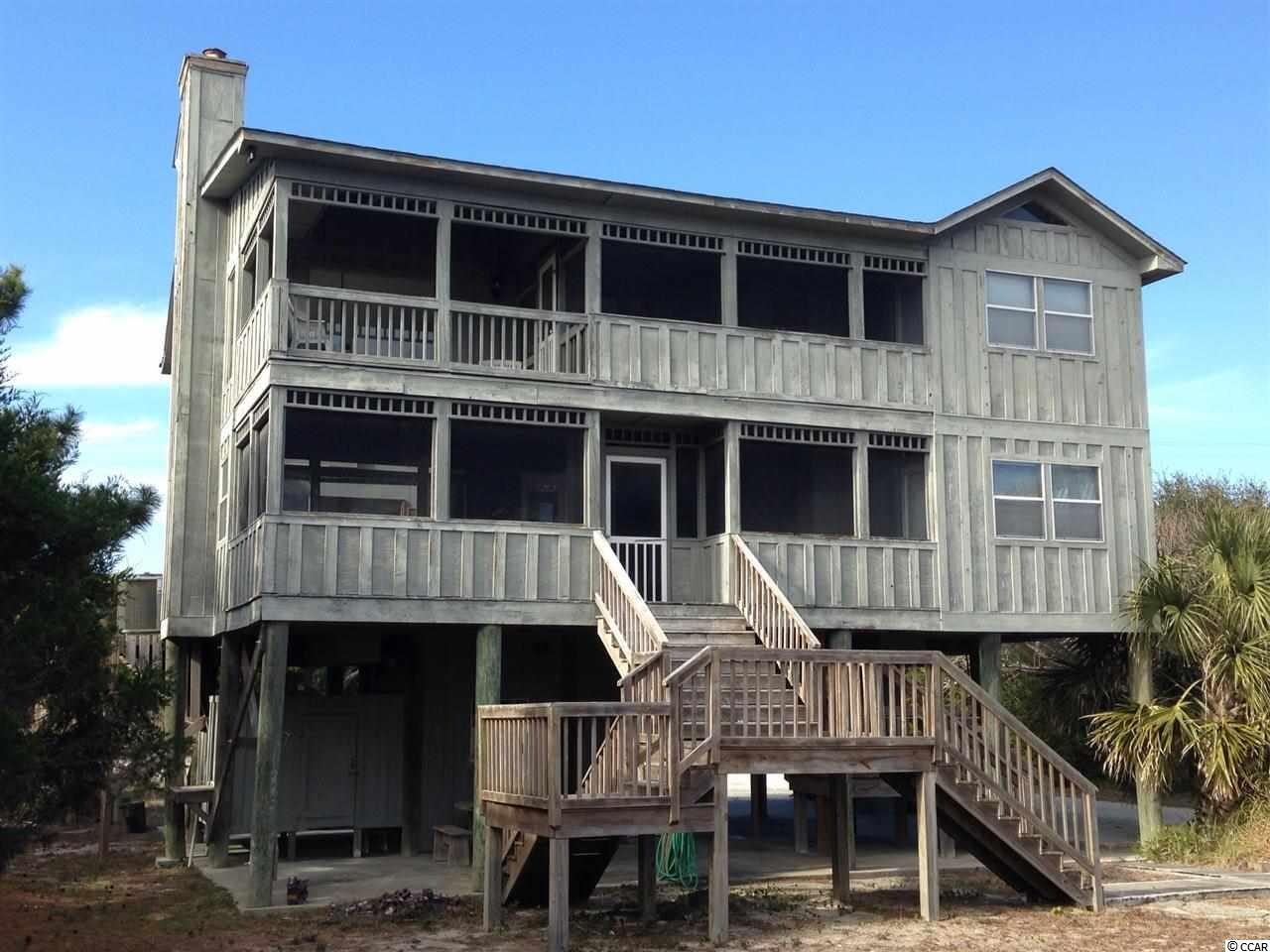 GREAT HOUSE   -    GREAT OCEAN VIEWS  -     PRIVATE BEACH WALKWAY               Wonderful Location at the North End of Pawleys Island.                              Four Bedroom Raised Drivin Pier Foundation Beach House. Wood floors, High ceilings, Screened Porches. Large Lot Location. Room for a POOL.      -  **** OCEANFRONT WITHOUT THE OCEANFRONT PRICE ****