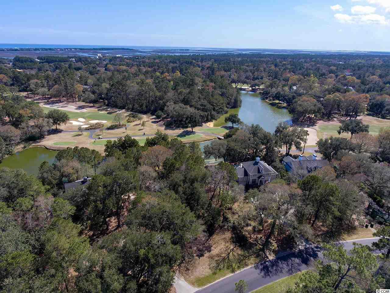 This is a spectacular property with wonderful expansive views overlooking a lovely lake and the 11th green of DeBordieu's famed Pete dye golf course. Centrally located close to all community amenities and priced to sell. Perfect location for either a permanent or second home. Plat on file for architect or contractor.