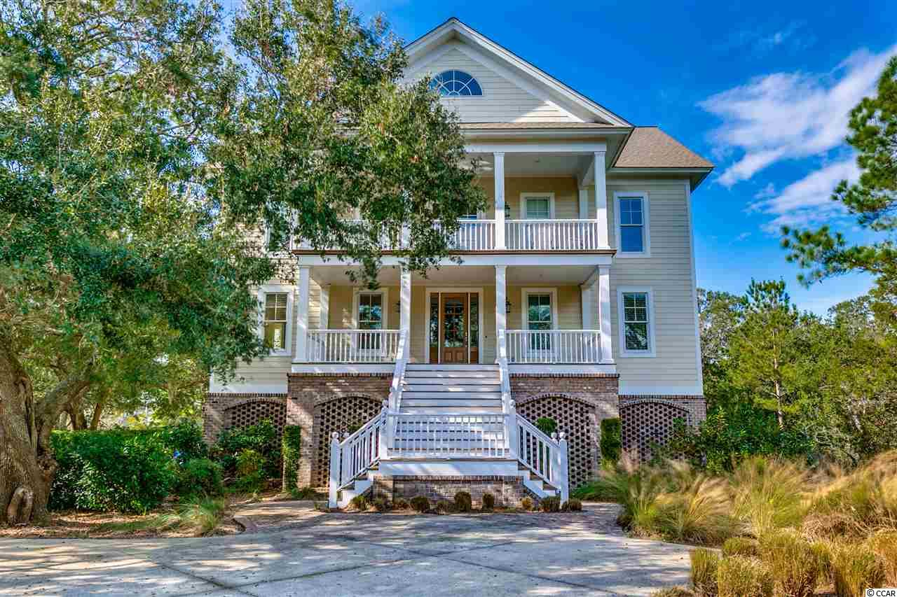 This DeBordieu Island Home is perfect for a large family (or two) that want views of the ocean, marsh, and lake! Nestled among beautifully mature live oaks, this spacious 7 bedroom, 7.5 bath home is located on the secluded south end of DeBordieu with beach access to the undeveloped 2.5 mile stretch of beach in front of Hobcaw Barony, yet just a golf cart ride away from fine dining and pools at the oceanfront beach club. The large 5200 sq. ft. open floor plan makes it easy to gather everyone together, while the two additional den/rec rooms offer space to spread out. Additional features inlcude: Elevator, porches, decks, lakefront setting, open gourmet kitchen, breakfast bar, granite counters, wet bar, hardwood floors, custom cabinetry, fireplace. The Square footage is approximate. Buyer is responsible for verification. DeBordieu Colony is an oceanfront community located just south of Pawleys Island, South Carolina featuring private golf and tennis, saltwater creek access to the ocean, a manned security gate, and luxury homes and villas surrounded by hundreds of acres of wildlife and nature preserves.