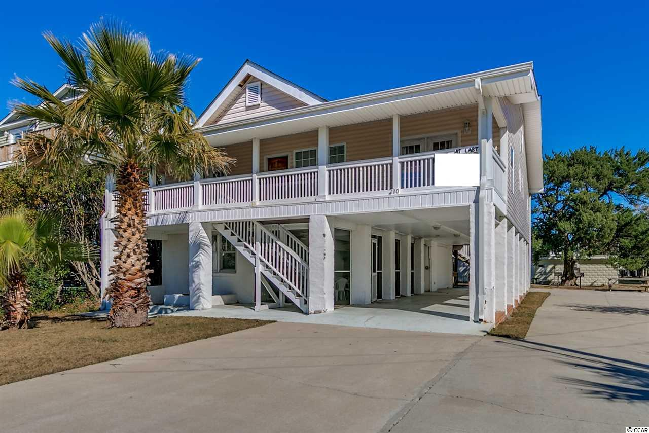 Pending contingent contract, the buyer has a due-diligence period that ends 11/19. 120 Vista Drive is located in Garden City Beach. Known as At Last, this classic detached beach house is located less than a block from the beach with five bedrooms, five bathrooms, approximately 2450 heated square feet and has two kitchens and two living rooms. Accommodating 14 people comfortably, every bedroom has its own bathroom and porch or balcony. Home sells fully furnished; just bring your toothbrush and swimsuit. The exterior offers plenty of outdoor living space with a ground level 24x12 screened in porch including a built-in charcoal grill, 40x9 covered front porch and two balconies off the rear bedrooms. There are covered patios and enough parking space for 12 cars. Golf cart conveys with sale of property. This property is like having two homes. Rent one floor and enjoy the other for yourself. Each floor has separate exterior entrances. It will offer you and your guests the privacy you're looking for. The location is convenient to the Garden City Beach small restaurant district and fishing pier. This versatile property is ready for whatever combination of beach living you're seeking. The property is sold exactly as seen. The sellers will make no repairs or corrections.