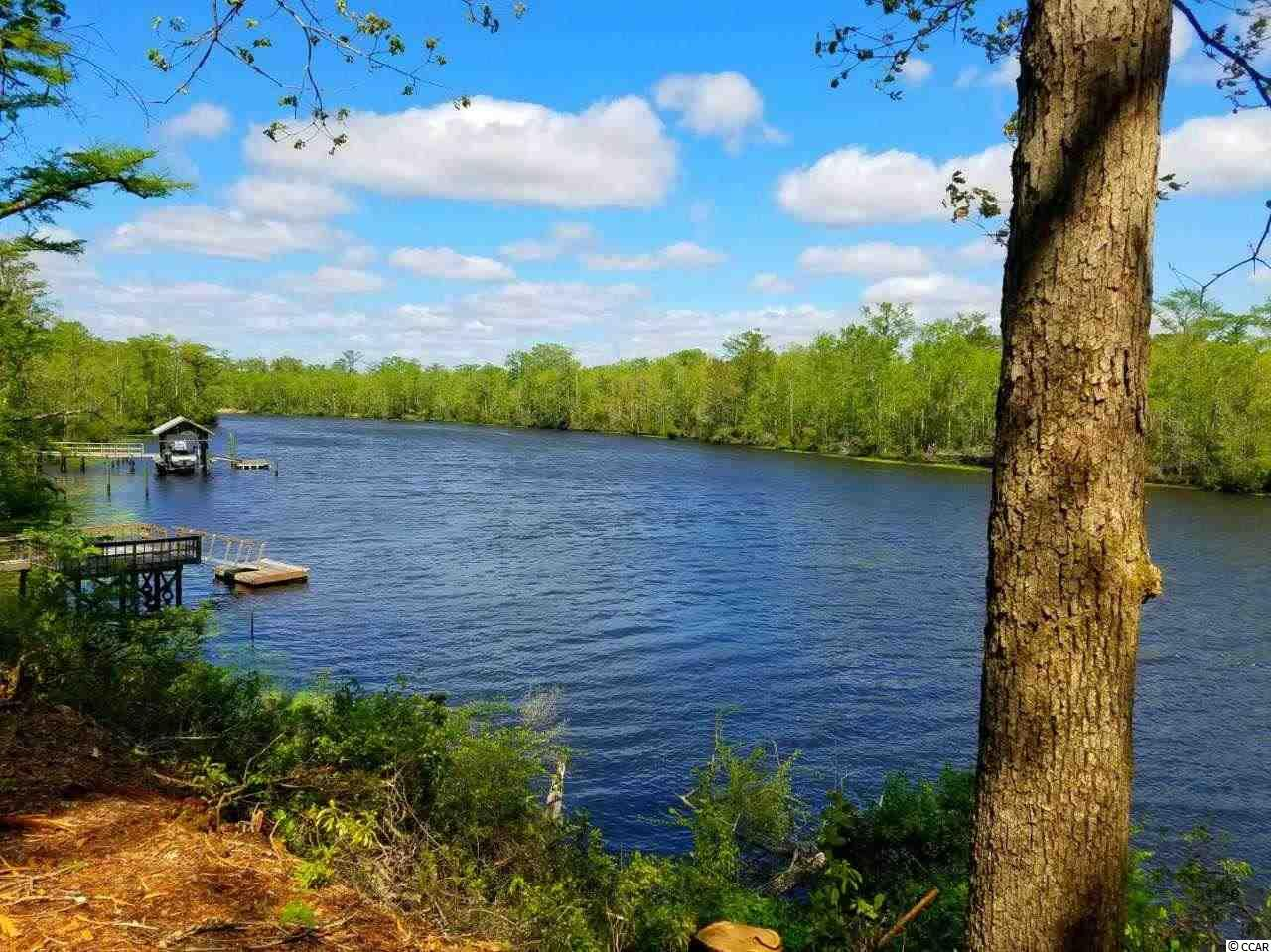 Oversized lot on a high bluff on the Black River with 119 feet of river frontage.  Outstanding views and gorgeous sunsets.  Located just outside of historic Georgetown, SC.  River gives access to the ICW and Atlantic Ocean.  Fresh water safe haven for your boat.   The river is absolutely beautiful, full of life and offers countless areas to explore. Residents enjoy fishing, hunting, water skiing, swimming, paddling or just cruising around taking in the plethora of wildlife activity.