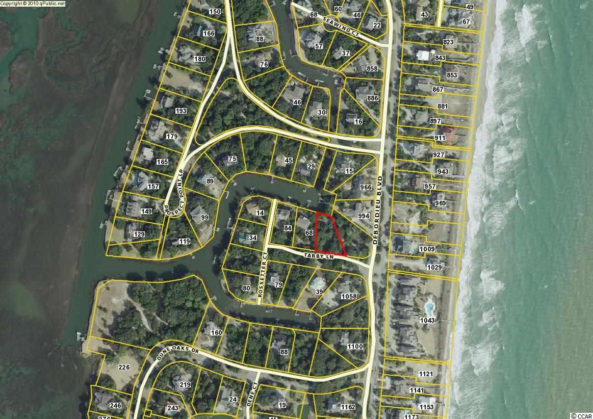 """Island Community - Beautiful homesite on DeBordieu's private Tabby Lane finger canal.  This is a prime spot for your new beach home - conveniently positioned right across the street from a beach access with space for you to put in a dock so that you can get out to Debidue Channel in seconds.  From there, enjoy fishing among the beautiful marsh grass in the creeks or cruise all the way out to the Atlantic.  DeBordieu Colony is a very private, oceanfront, gated community located near Pawleys Island, South Carolina on the coast between Charleston and Myrtle Beach. The onsite private DeBordieu Club offers amenities such as golf, tennis, and multiple dining options to DeBordieu Club members and guests. Natural amenities include miles of beach and tidal creeks, an on-site nature preserve with walking trails and bike paths, and a delightful year round climate. DeBordieu is home to a limited number of fortunate folks that enjoy the finest '""""Lowcountry Lifestyle"""" as either permanent residents or second home owners."""