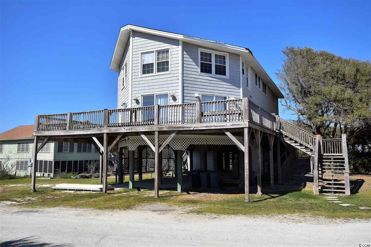 """PRICE REDUCED! Pawleys Island Beach. 6 Bedroom/ 3 Bath Raised Beach House on the East Side of Myrtle Ave. Lot In the Creek (with Dock Permit) conveys with the House. Views of the Creek from the Open Family Room. Access to the Beach and the Blue Atlantic. Easement Beach Access. Two story w/ Carolina Room on 1st Floor w/ Creek Views & Family Room on 2nd Floor with Creek Views. Ocean Views from the wrap around Porch. Build your own Dock & fish, crab & boat in the creek. Close to Shopping, Dining & Golf. Rental History Available. Built 1974. Ocean Front Lot is also """"For Sale"""" and seller will consider selling 1/2 to Buyer of 344A or 344B."""