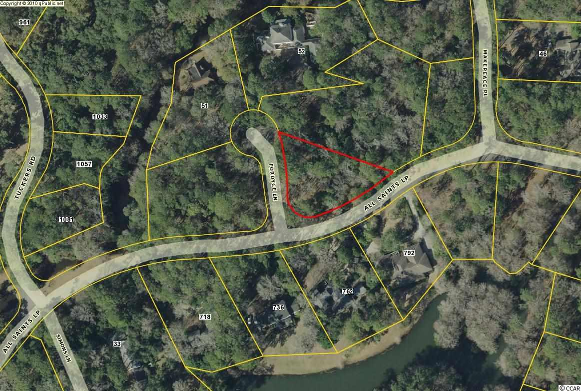 Beautiful wooded, corner lot in Litchfield Plantation, one of the oldest and most historic plantations in the area.  House plans available!  This is a gated community offering 24 hour security.  Enter on the Avenue of Live Oaks which is a beautiful tree lined street leading up to the historic plantation house built in the 1700s.  Other amenities include access to private beach house, pool and more!  Litchfield is conveniently located just a 70 mile drive to historic Charleston, SC and a 25 mile drive to the attractions of Myrtle Beach!