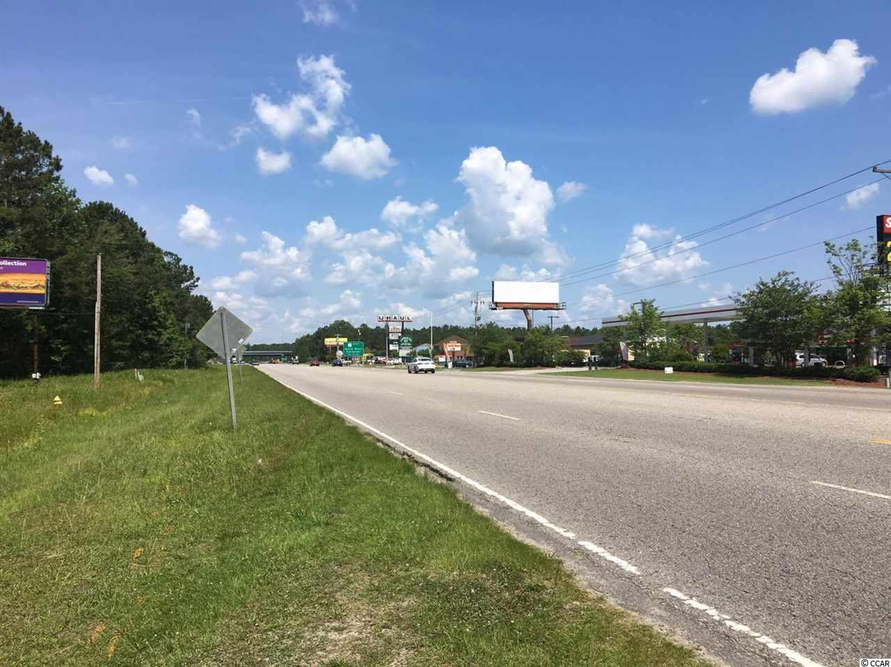 With over 200 feet of direct highway frontage just after the exit from hwy 31 Site is located in one of the busiest hwy in the county. Great area for fast food or retail. Join Food Lion, State farm, Horry County National Bank,at this great commercial location. Acreage is approximate and not guaranteed. Buyer is responsible for verification. price reduced!!