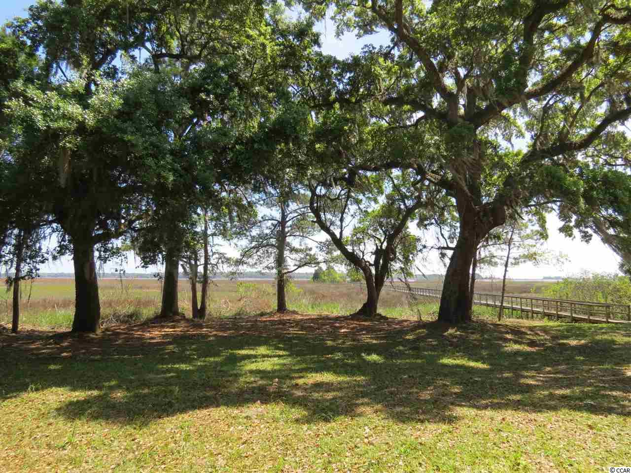 Whitehall Plantation, Georgetown. Gated Historic Plantation setting with only six 2+ acre home sites in the community. As you drive through the beautiful landscaped brick entrance and through the historic live oaks to the end of the road you will find this home site consisting of 18.7 acres with approx. 2 acres high ground and the balance in bay marsh with a navigable creek and dock. Beautiful views of the bay, Intracoastal Waterway, views of the Waccamaw River Bridge in the distance and views of Belle Isle Marina. Whitehall Plantation offers a community boardwalk out into Winyah Bay with a floating dock.
