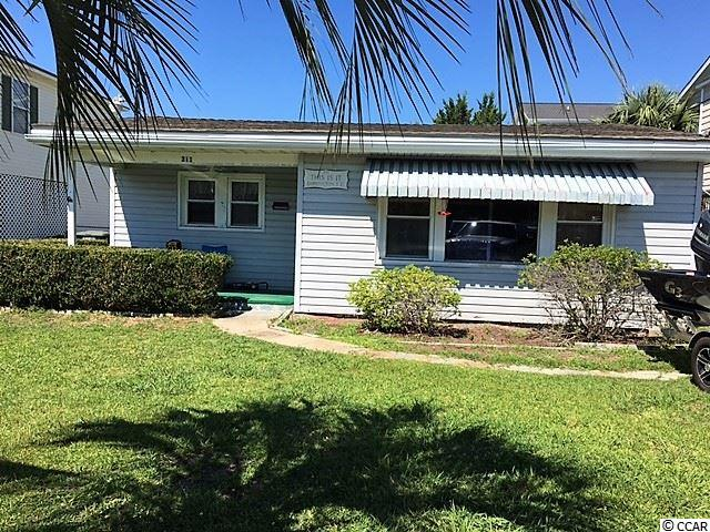 "If you're hunting for the perfect beach location, this is it! Only 2 short blocks to the ocean in the heart of Cherry Grove, and just two blocks off Sea Mountain Hwy. Walk to the grocery store, hardware store, beachwear store, ice cream shop, bike shop, multiple restaurants, liquor store, post office, and so much more. This home has been owned by the same family for 40+ years and never rented. There is a 16X14 block storage building in the backyard to keep your lawn equipment and beach supplies in - no bringing sand into this home! Enter into a large 19X12'6"" living area with dining area and lots of light. Galley style kitchen with newer refrigerator. Split bedroom plan. Come see for yourself, you'll be glad you did. The price is right to live this close to the ocean!"