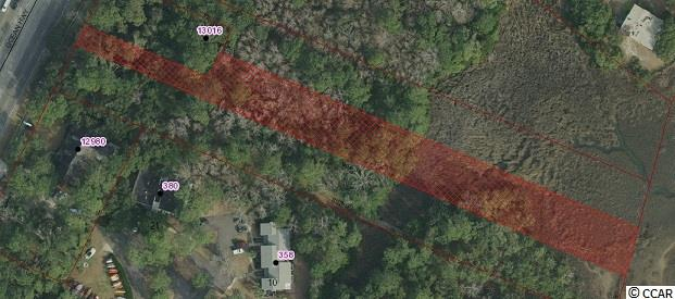 Are you looking for a secluded, unique, yet close to everything lot to build your dream home on, one that also includes beautiful views of the Pawleys Island marsh? Then you need to look in to this one of a kind piece of heaven.   Prime real estate south of Litchfield Dr, across from Health Point and just south of the Litchfield Fish House. The lot is over 850 feet deep and runs from Ocean Hwy (Hwy 17) all the way to the marsh. With long range views over the marsh to the Litchfield Beach area and NO HOA make this 1.2 acres one that needs to be looked at TODAY!