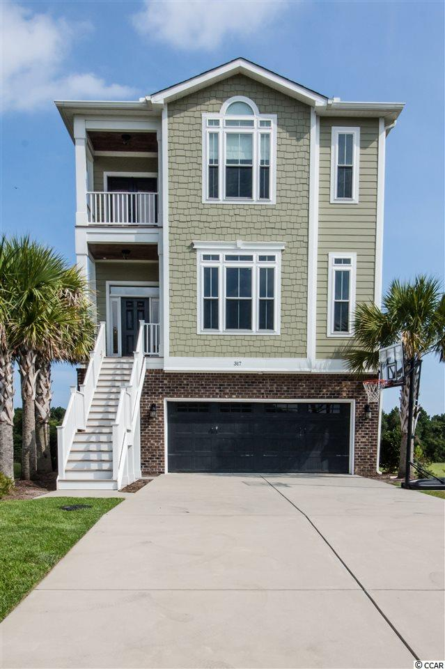 Stunning 5 BR/4 BA Charleston style home overlooking the sparkling Intracoastal Waterway with boat lift/dock and outdoor summer kitchen already in place!  The ground floor features a guest room, full bath, den and kitchen area that would make a great mother-in law suite or simply great entertaining space. Second floor open-plan offers living and dining areas along with a dream kitchen -- gas cook top, built-in ice machine and a huge walk-in pantry.  There is also another bedroom/office and full bath.  The Master suite and 2 additional bedrooms and baths are located on the top floor with panoramic waterway views and a covered porch perfect for a hammock and late afternoon breezes.  This home is like new and could not be built today at this price.  Back yard is already graded and fenced making it easy and economical to add a pool if you wish! This home is in The Battery on the Waterway which is a cozy gated community with boat storage, day docks, and an just an 8 minute golf cart or bike ride to the beach via the East Coast greenway trail just outside the neighborhood.  The Bike and Run Park is adjacent to the community as well.  Looking for a small community where you can get to know your neighbors and love life on the water?  Do not miss seeing this home today!