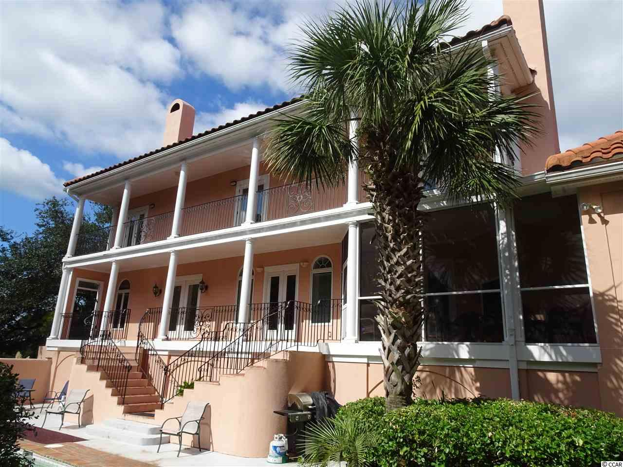 Low Country Charleston Home surrounded by majestic live oaks located in the beautiful ocean front community of DeBordieu Colony just south of Pawleys Island, SC. Wide porches and veranda are accessed from almost every room of the home and overlook a wonderful private pool. This traditional home features large living and dining rooms, perfect for family and entertaining, with the open kitchen, den and screened porch serving as the central hub of everyday living. The second floor features 3 bedrooms and two baths with each bedroom featuring double doors to the second floor veranda. The third floor bedroom is best accessed by the elevator but also features a secret back stair. The 5th bedroom is located on the ground floor and features a private bath. 243 Dune oaks is located on a quiet street on the south end of DeBordieu with easy access to the beach and just across the street form the beautiful North Inlet estuary. All information should be verified by the Buyer.