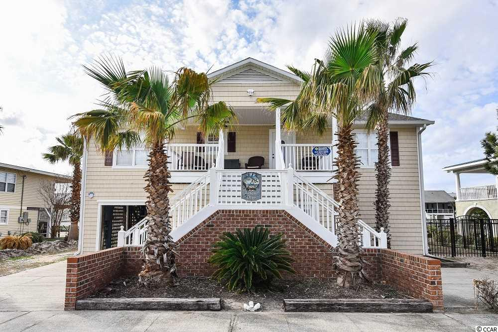 This beautiful inlet front home with a private pool also has a pool heater! It has a partial view to the ocean from the front porch and a private floating dock in the rear. This house offers 2 living room areas and has NEW WOOD FLOORS DOWNSTAIRS AND UPSTAIRS! Perfect for an investment property (great rental income) or primary/second home.