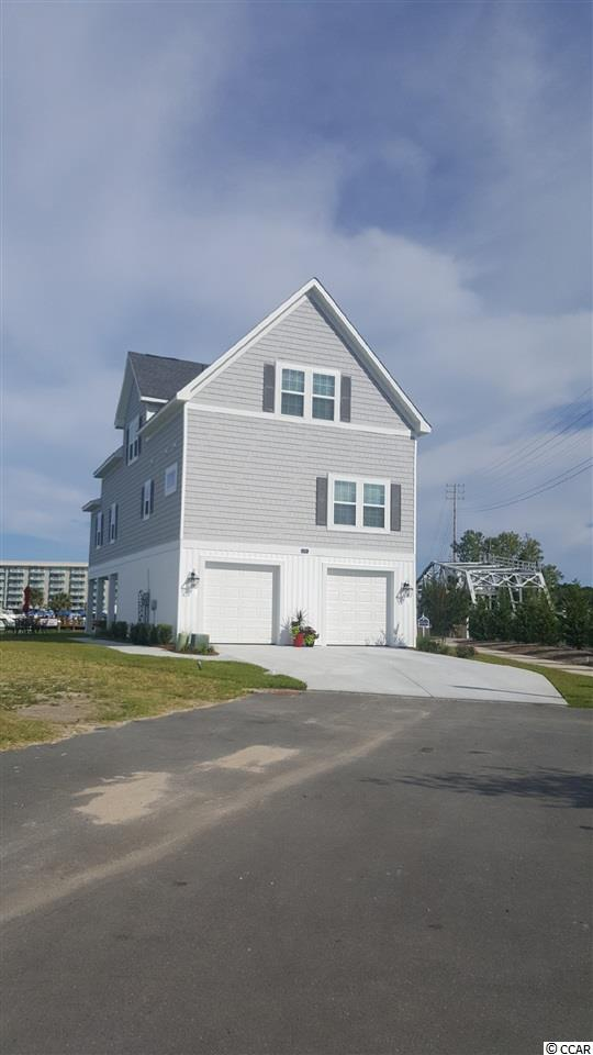 """Now Pre-Selling """"Cape Cod Cottages a Water Front Community situated on the Intercoastal Waterway,"""" Reserve Your New Home Today! Enjoy the beautiful views of the marsh and the Intercoastal Waterway from your porch. Our quaint community consists of only 32 homes. The Cape Cod style Cottages come in 3 and 4 bedroom floor plans. The Cottages are situated in Little River directly on the Intercoastal Waterway. You will fall in love with open floor plans and the true feel of a New England style neighborhood. Featuring • Open floor plan with lots of windows • 9 foot ceilings on all floors • Ceiling fans • Crown molding in the living-room, dinning room & master bedroom • Granite counter tops in the kitchen and bathrooms • Stainless steel kitchen appliances with designer cabinets • Brushed nickel fixtures throughout • Tiled showers along with Comfort height toilets • Upgraded wood flooring in the living areas • Spacious master & guest bedrooms include Jack & Jill style bathroom • Garage doors with opener and parking space for up to 3 cars. Enjoy the day dock with your family and friends, there is plenty of dock space to dock your boat. We have done all the work for you, all you need, is to move in and start enjoying the life style at """"Cape Cod Cottages on the Waterway"""" a prime location to call home :) Ask about our Holiday builder Gifts & Incentives!"""