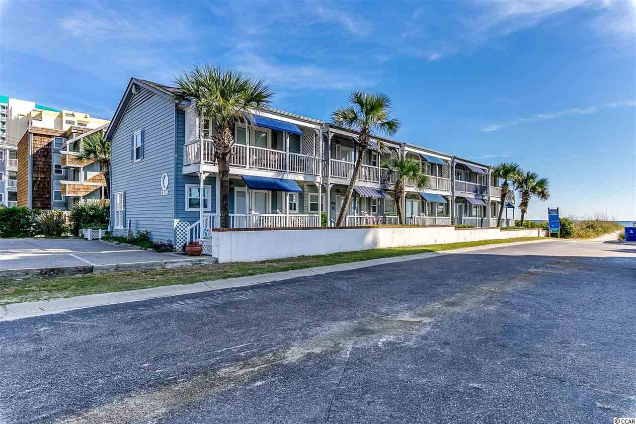 Welcome home to Long Bay Landing and your own piece of paradise located right on the beach in the Crescent Beach section of North Myrtle Beach.  This 3 bed/ 2 1/2 bath townhome has been completely remodeled.  Everything has been replaced and upgraded including real wood flooring in the living and formal dining rooms, tile and granite counters in the kitchen and baths, HVAC System and even a new roof. Your new home is completely furnished and ready for you to move right in.  Sit and relax on the balcony off the master bedroom and listen to the waves crash on the shore.  There is also a porch on the first floor with room for friends and family to enjoy the beautiful views.  Whether you are looking for a permanent residence, a vacation get-a-way, or an investment property, you won't want to miss this one....schedule your showing today!
