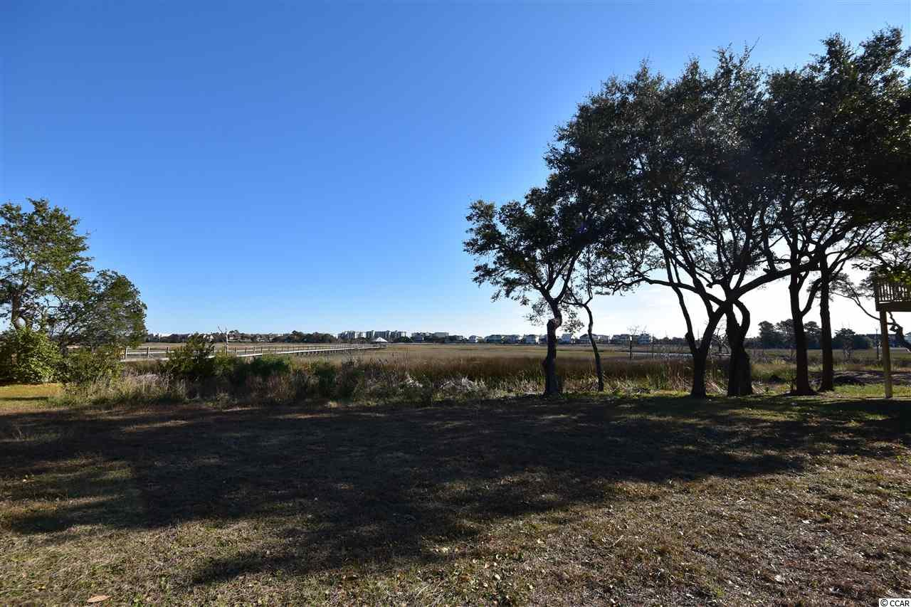 A RARE CREEK FRONT & MARSH FRONT BUILDING lot in LITCHFIELD. Raised beach style homes in this community. Breath taking views! Perfect location between Georgetown & Murrells Inlet. Shopping, restaurants, beach access' in North & South Litchfield beaches. Easy access to Waccamaw River. Also between Myrtle Beach & Charleston for all the arts & entertainment.